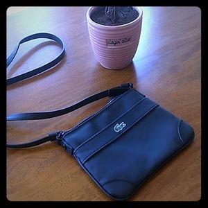 Lacoste flat crossover handbag.